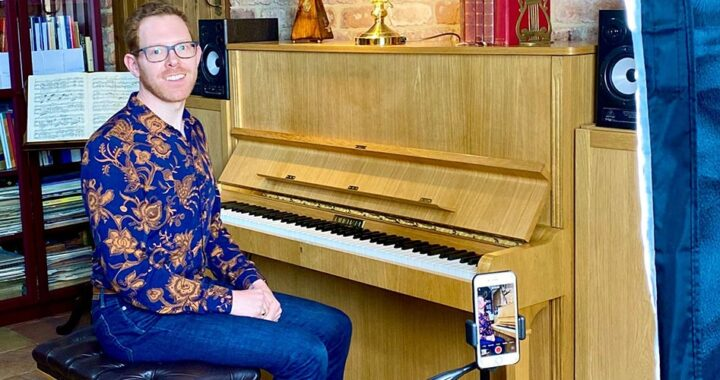 Jonathan Delbridge sitting at piano