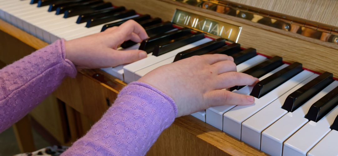 Lucinda piano hands close-up