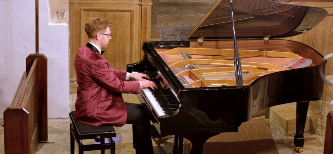 Jonathan Delbridge Playing piano